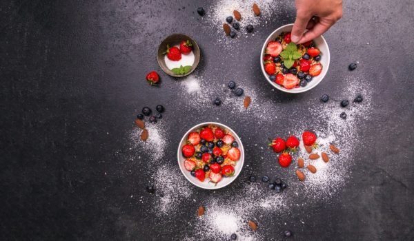 chef puts fruit in bowls
