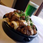 lamb poutine with green beer